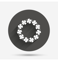 Wreath of clovers with four leaves sign vector