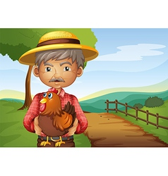 An old man holding a rooster vector image vector image