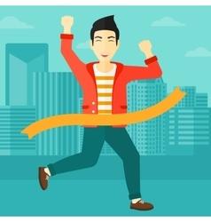 Businessman crossing finish line vector image