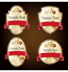 Set of gold ornate labels with red tape vector