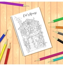 Spiral bound notepad or coloring book with pencils vector