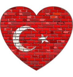 Flag of turkey on a brick wall in heart shape vector