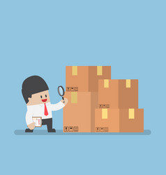Businessman checking parcel box by magnifying vector