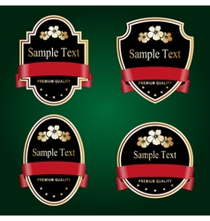Set of black and gold ornate labels with red tape vector