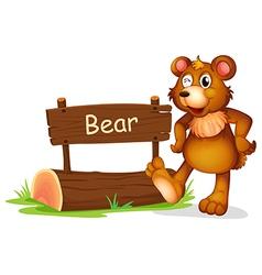 A bear beside a sign board vector image