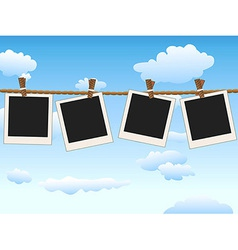 Hanging blank photo frames on blue sky vector