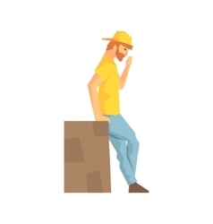 Worker taking a break leaning against large box vector
