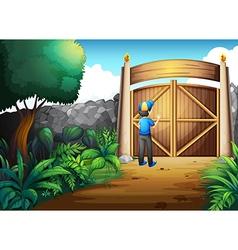 A boy near the gate vector image