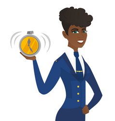 Arican-american stewardess holding alarm clock vector