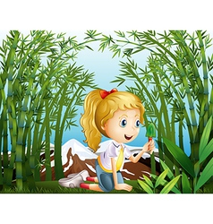 A girl with a green shovel kneeling in the vector image