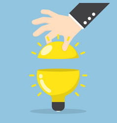 Businessman hand open the light bulb vector