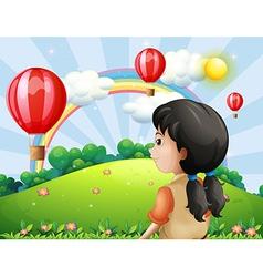 A girl looking at the hot air balloon vector image vector image