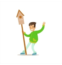 Boy with birdhouse helping in eco-friendly vector
