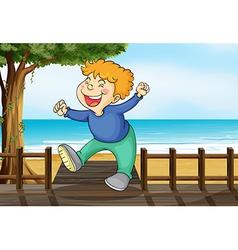 A very happy boy at the bridge vector image vector image