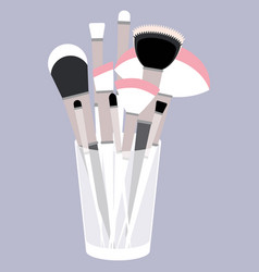 with glass and makeup brushes vector image