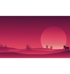 Silhouette of wolf in hills scenery vector