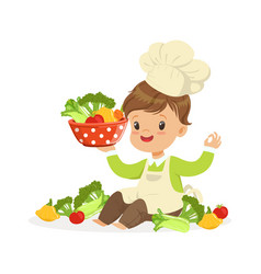 cute little boy chef cooking fresh vegetables vector image