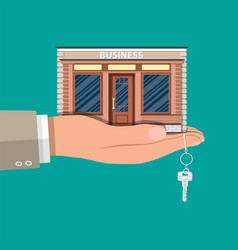 hand holding shop or commercial property with key vector image