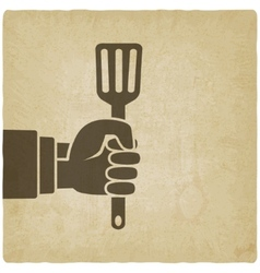 chef hand with turner vector image