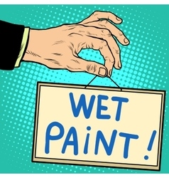 Hand holding a sign wet paint vector image vector image