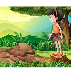 A little girl standing above the stump vector image