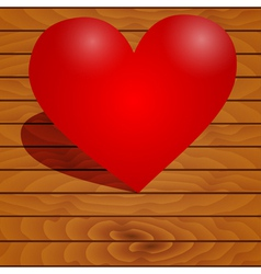 Heart on a wooden background vector image
