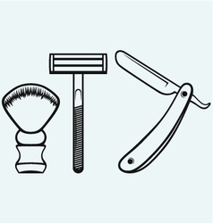 Straight razor and shaving brush vector