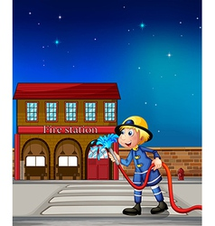 A fireman near a fire station vector image