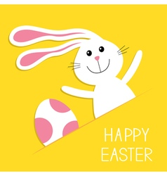 Happy easter bunny rabbit hareand pink painted egg vector