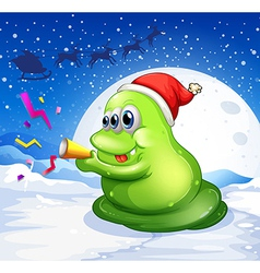 A monster with a red hat playing at the snowy land vector
