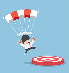 Businessman with a parachute landing on a target vector