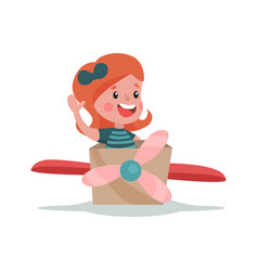 adorable little girl playing with cardboard vector image