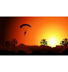 Person parachuting in the sunset vector