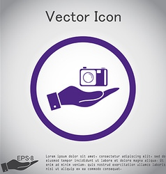 Hand holding a photo camera vector