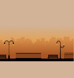 Silhouette of street lamp on garden landscape vector