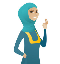 Young muslim business woman showing ok sign vector