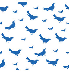Blue bird silhouettes seamless pattern vector