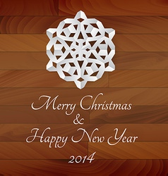 white paper snowflake on a wooden background vector image