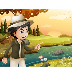 A man with a hat at the riverbank vector image vector image