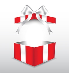Red gift box with white ribbon vector