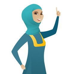Young muslim business woman pointing her finger up vector