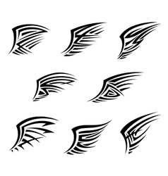 Black wings in tribal tattoo style vector