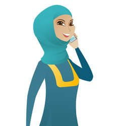 Muslim business woman talking on a mobile phone vector