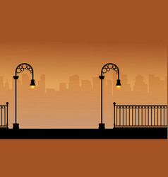 Silhouette of fence with street lamp landscape vector