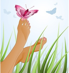 A womans feet lying on a grass with a butterfly vector