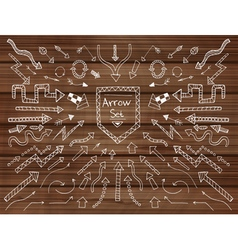 Hand drawn arrows on wooden texture vector