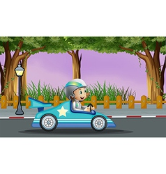 A boy in his blue racing car with a white star vector image