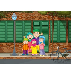 Muslim family standing by the road vector image