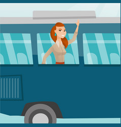 Young caucasian woman waving hand from bus window vector