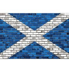 Grunge flag of scotland on a brick wall vector